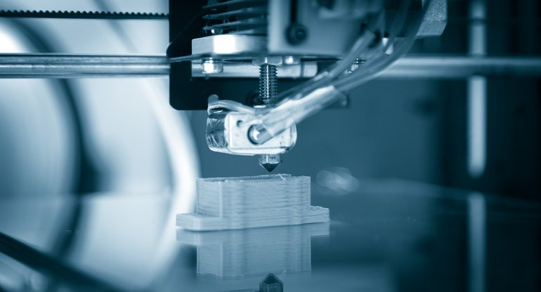Electronic_three_dimensional_plastic_printer_during_work_,_3D_printer,_3D_printing