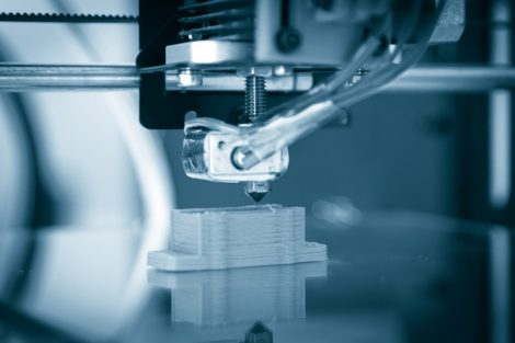 Electronic_three_dimensional_plastic_printer_during_work_,_3D_printer,_3D_printing
