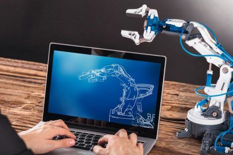 Close-up_Of_Businessperson_Working_On_Design_Of_Industrial_Robot_Arm_On_Laptop