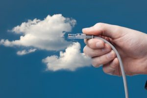 Cloud_computing_concept._Hand_with_ethernet_cable_connecting_into_cloud._