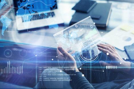 Man_working_on_a_project_using_futuristic_digital_tablet