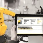 Industry_4.0_concept_.Man_hand_holding_tablet_with_Augmented_reality_screen_software_and_blue_tone_of_automate_wireless_Robot_arm_in_smart_factory_background